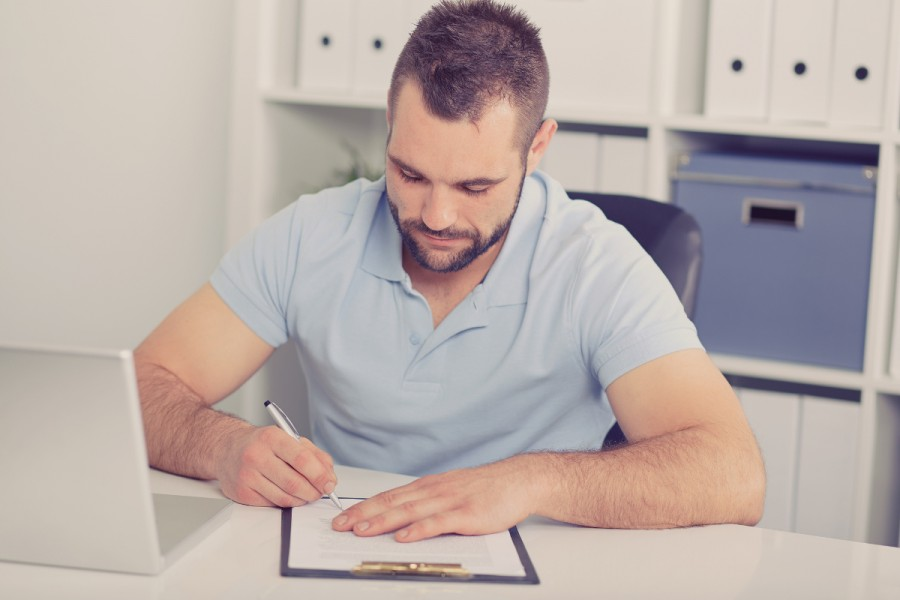 A man signs a contract