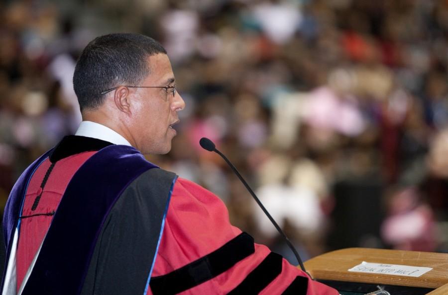 A former student addresses a graduating class